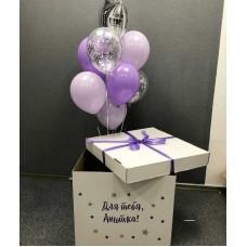 Коробка с фиолетовыми шарами